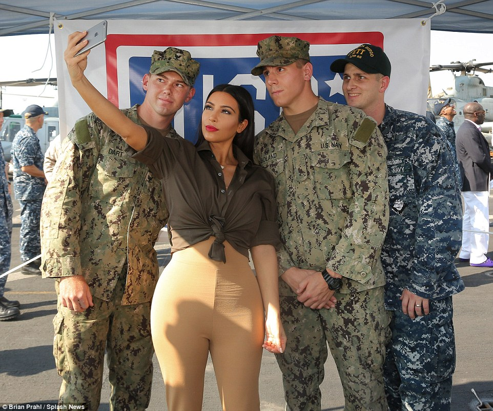 Selfie time! Professional poser Kim showed her patriotism by talking to (and posing with) delighted servicemen and women aboard the USS San Diego