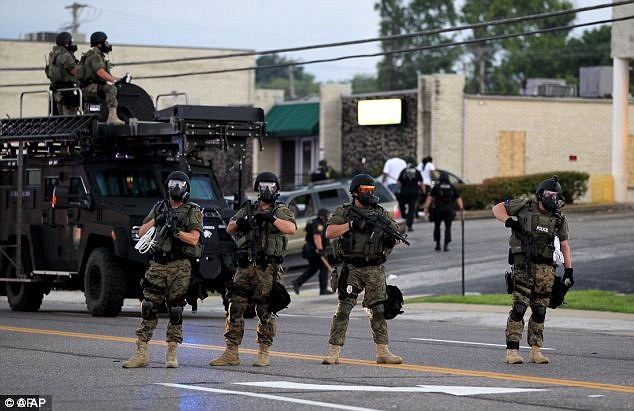 Paramilitary: Police in the war-torn Missouri suburb of Ferguson , like many local forces large and small, participates in a federal program that arms them with surplus battlefield weapons, armor and combat vehicles