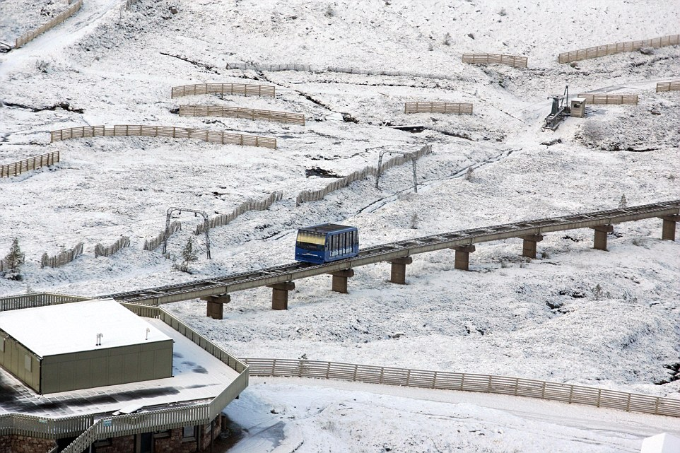 An image of the funicular railway at Cairngorm shows snow has settled, but it is unlikely to lie in England