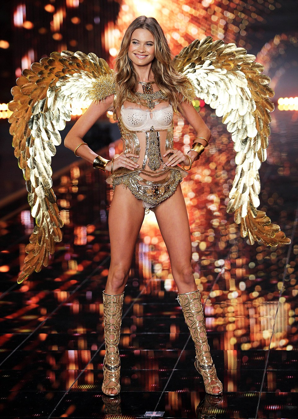 True beauty: Behati Prinsloo beamed as she got to the end of the runway during her segment