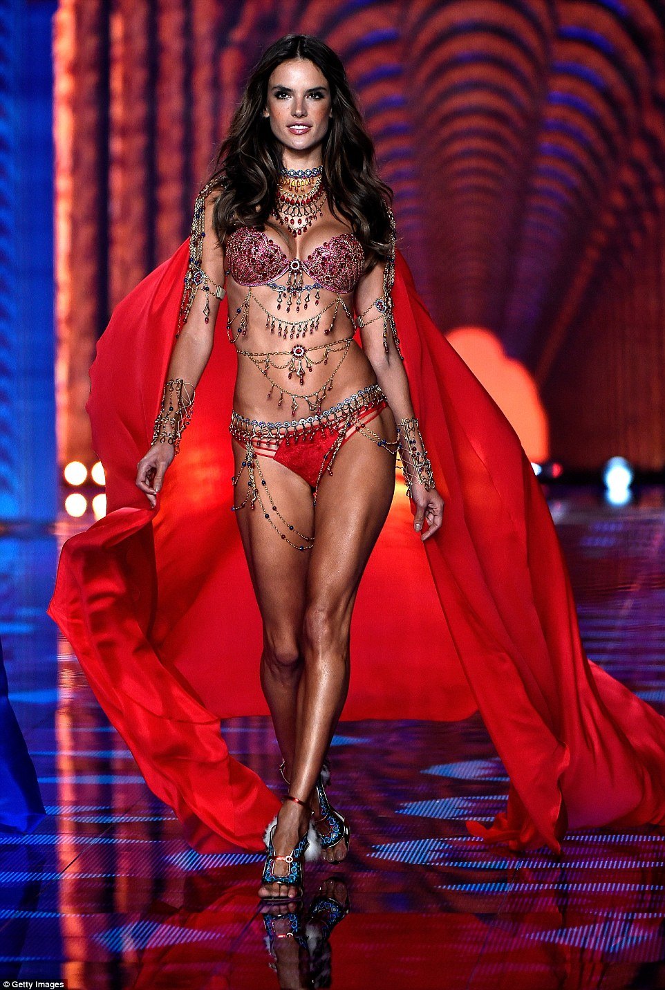 Brazilian goddess: Alessandra, 33, looked more glorious than ever in the red, glitzy item and flowing red cape behind her, as she revealed her impressively toned thighs