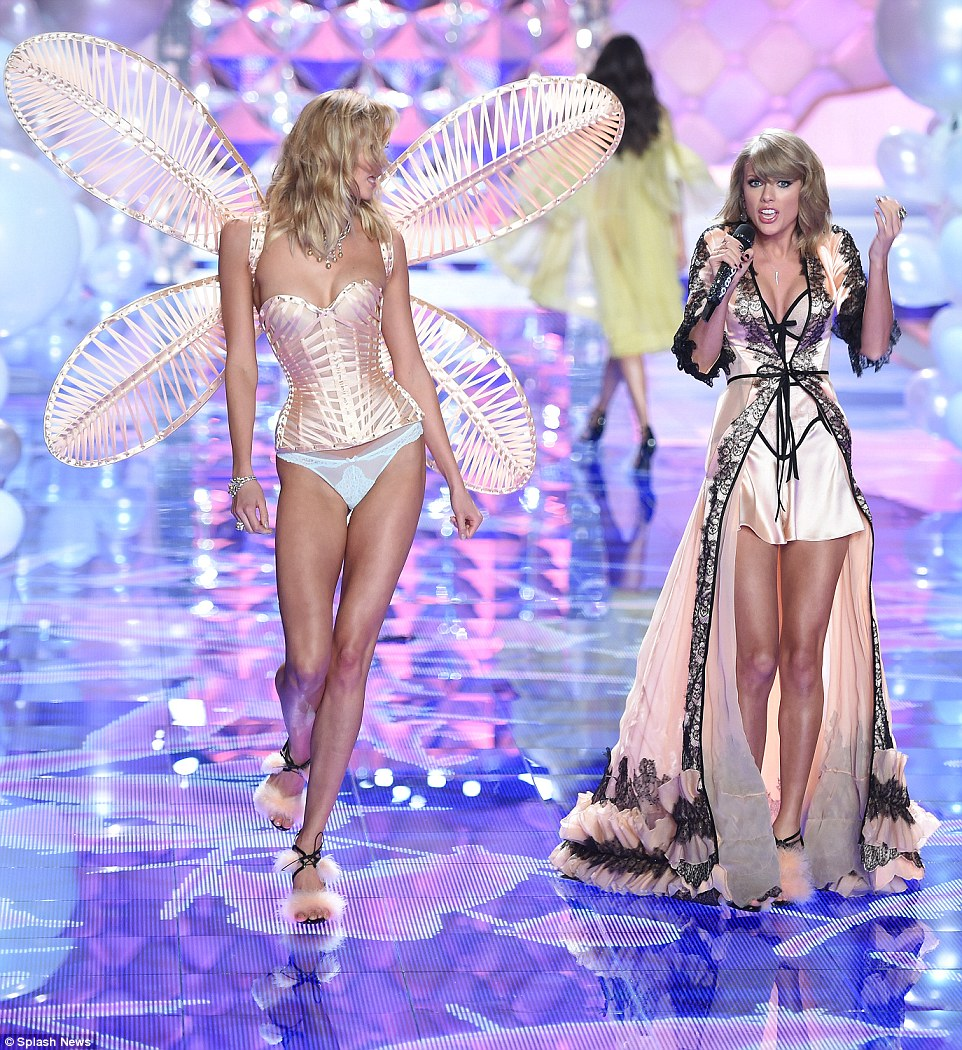 Oh sweet music: While Karlie shimmied along the catwalk, the songstress serenaded her
