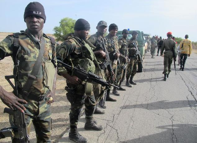 In Dabanga, Cameroon, on June 17, 2014, Cameroonian soldiers are deployed as part of a reinforcement of its military forces against Nigerian Islamist group B...