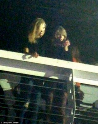 Soaking it in: The Twitter user spotted the BFFs enjoying an evening of live music from a balcony
