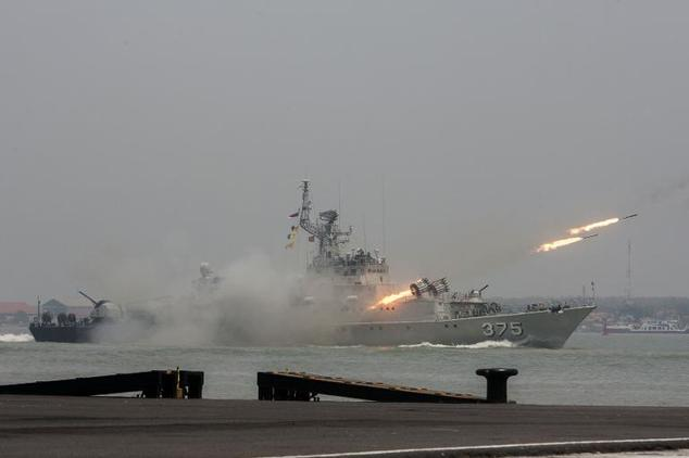 An Indonesian warship launches rounds of missiles during the celebration of the 69th anniversary of the Indonesian armed forces in Surabaya in eastern Java i...