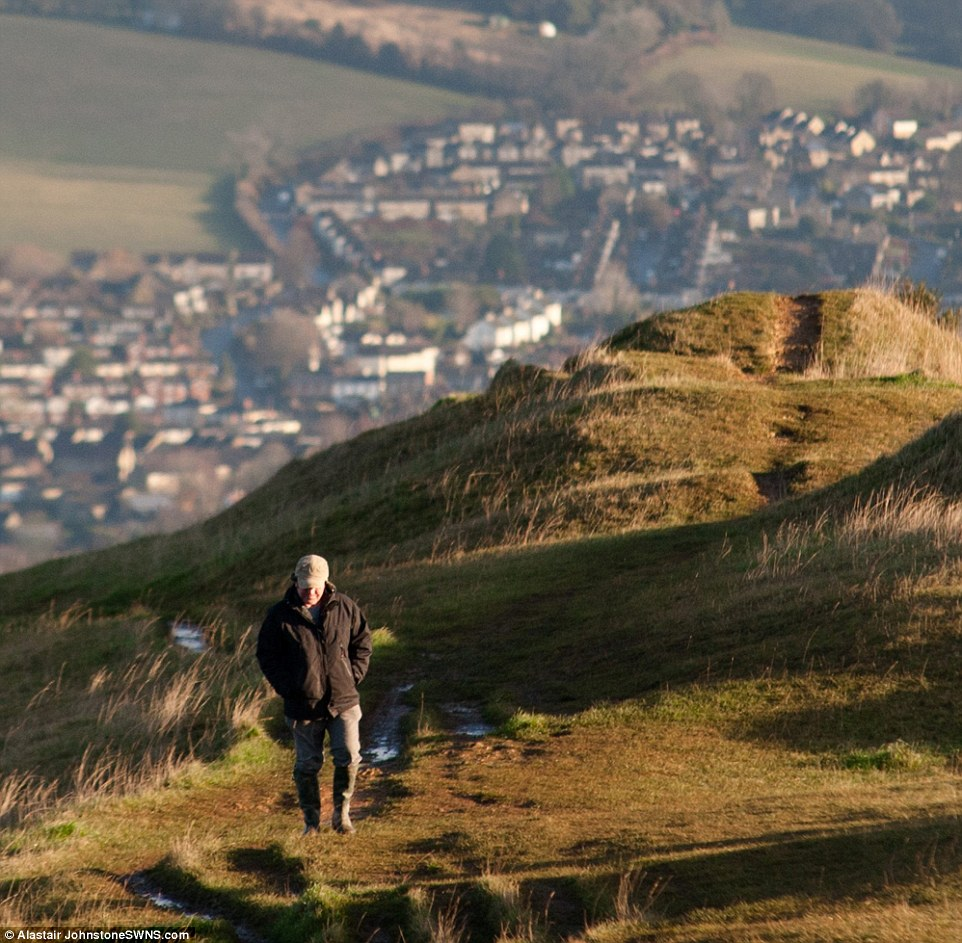 Winter sunshine: The Met Office said some parts of the country would see some bright sunshine today, including near Stroud, Gloucestershire (pictured), following a night of cold temperatures and heavy frost. Heavy rain, hail and sleet is set to return towards the beginning of next week