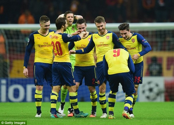 Arsenal's players react to the Welshman's brilliant volley to take the score to 3-0 in Istanbul