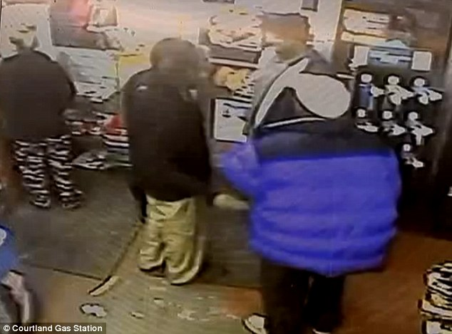 Caught on camera: Jessica (seen left) then went into the shop and paid while three men chatted nearby