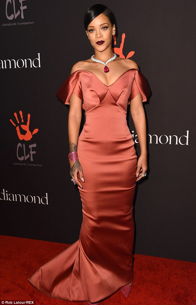 Night to remember: Rihanna donned an elegantly trailing rose satin gown to attend her first ever Diamond Ball at The Vineyard in Beverly Hills on Thursday
