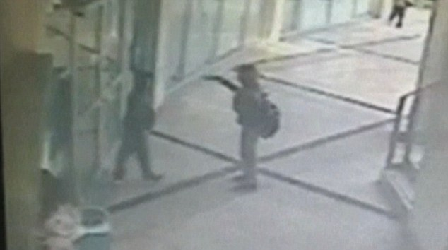 Cops and robbers: The 12-year-old and his 13-year-old accomplice were caught on CCTV as they entered a bank in Rishon Lezion, a suburb of Tel Aviv