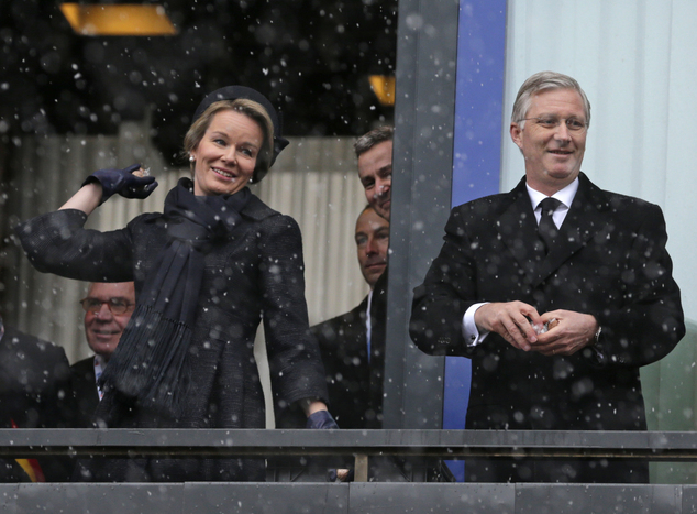 In homage to the U.S. Army General Anthony McAuliffe, who responded: 'Nuts!' when confronted with an ultimatum by the German army, the Belgian royal family threw nuts into the crowds today