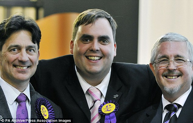 Kerry Smith (centre) was recorded making a series of astonishing comments including a baseless claim Nigel Farage had accepted 'a nice fat envelope' for promoting a Ukip ally