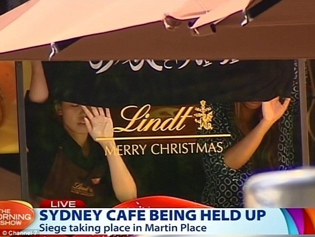 Terrorists were today holding hostages in an armed siege in a cafe in Sydney where an extremist flag was held up in the window