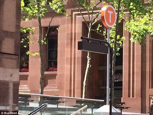It is unclear how many people are involved in the siege in a Lindt cafe in Martin Place but people could be seen with their hands pressed against the windows