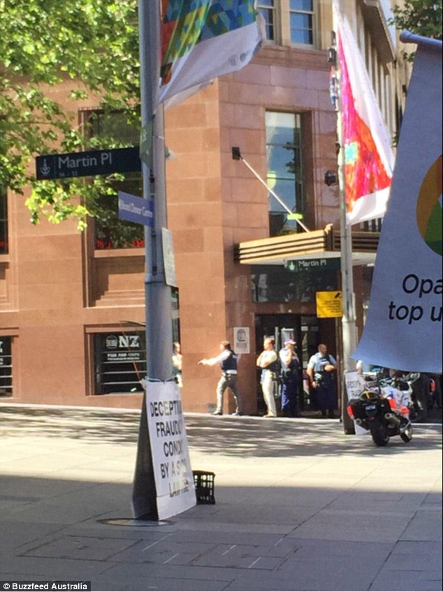 Armed NSW police officers surrounded the busy cafe following reports of armed gunmen inside