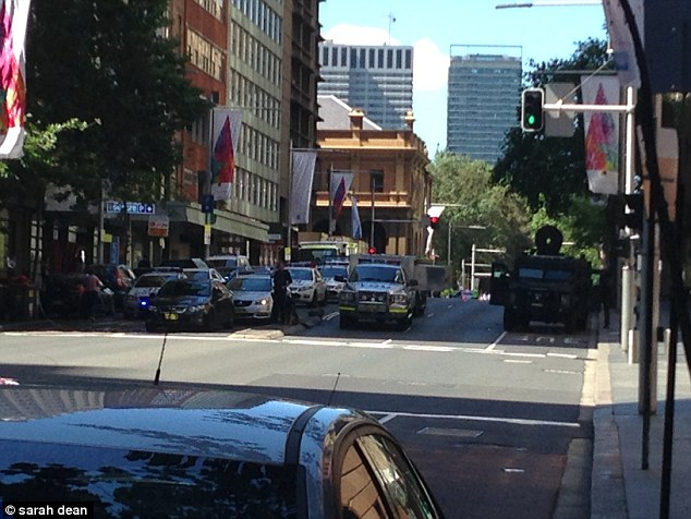 Martin Place has been shut down and scores of police are surrounding the building after the alarm was raised about 9.45am