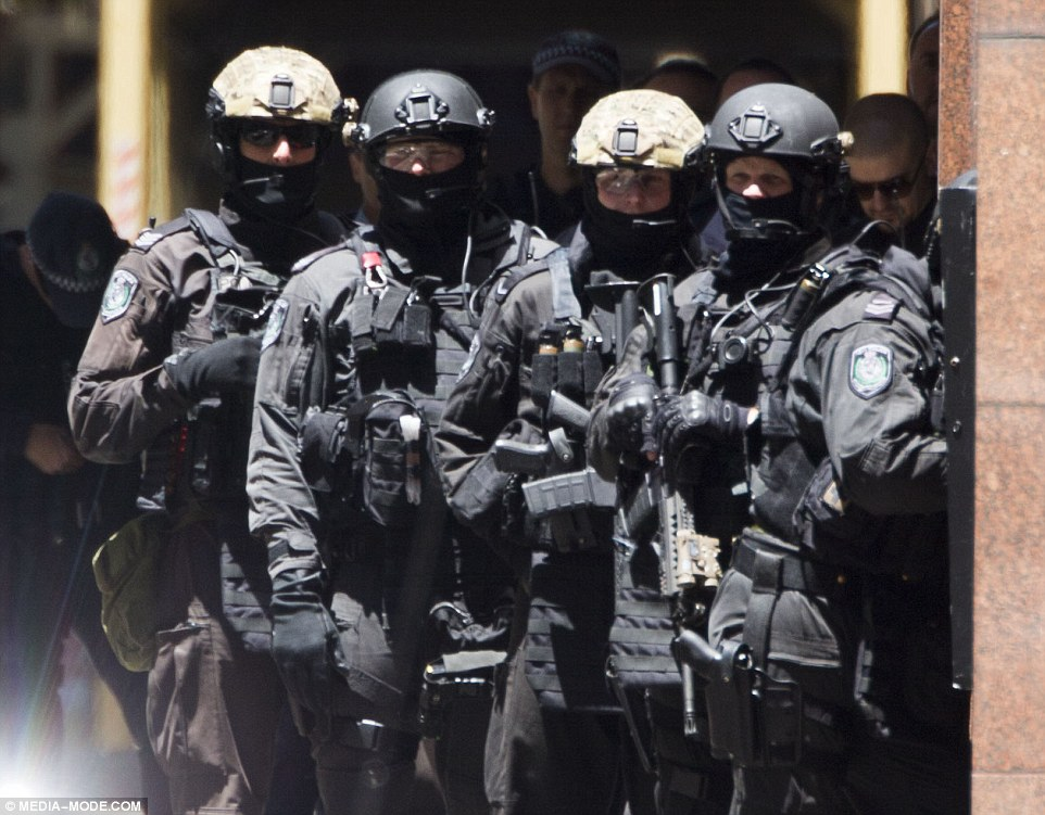 Scores of police have surrounded the cafe in Martin Place amid claims the terrorists are also armed with a machete and may have explosives
