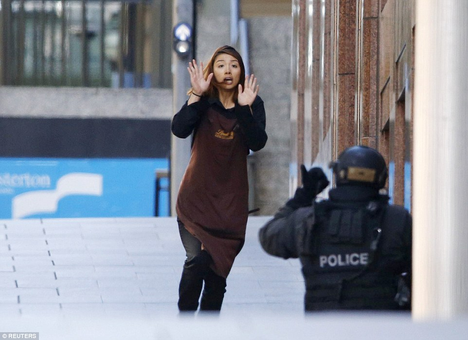 'Omg Elly!! So glad you're OK': Ms Chen, pictured, was the fifth hostage, scrambling from the cafe with her hands in the air