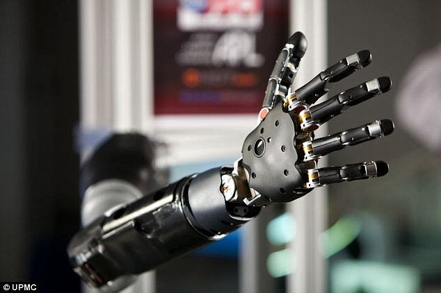 Computer algorithms were used to decode brain signals and identify the patterns associated with a particular arm movement. The researchers then used a virtual reality computer program to calibrate Ms Scheuermann's control over the robotic arm (pictured)