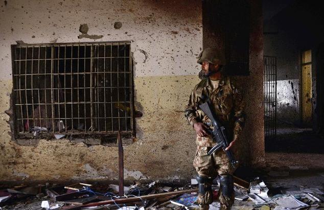 A Pakistani soldier stands guard at the site of the militants' attack on a school in Peshawar, on December 18, 2014 as Prime Minister Nawaz Sharif vowed to c...