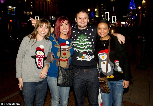 Friends link arms in their festive jumpers on the busiest drinking night of the year across the country