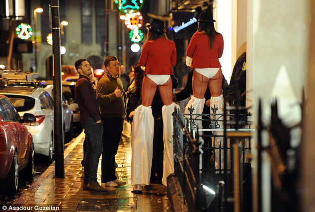 Also in Leeds, two men try their luck with women on stilts on the night that is the start of the festive period