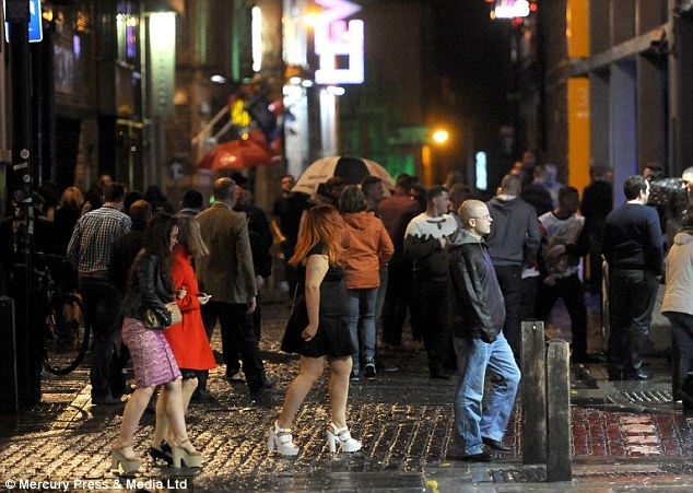 Crowds of revellers brave the wet weather to take to the streets of Liverpool on Mad Friday