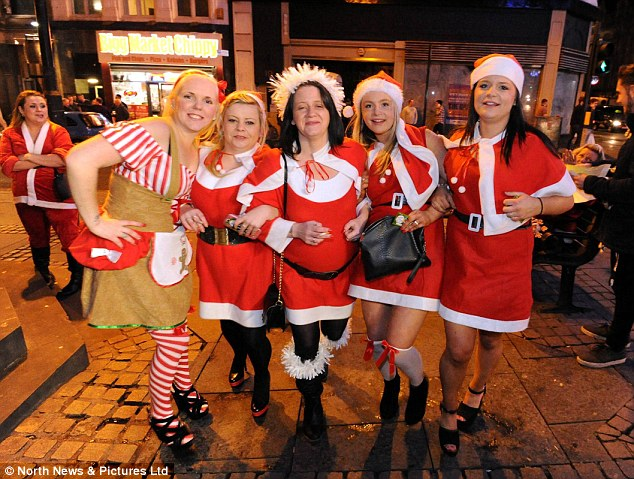 A group of women dressed up as Santa on the biggest night of the Christmas party season in Newcastle