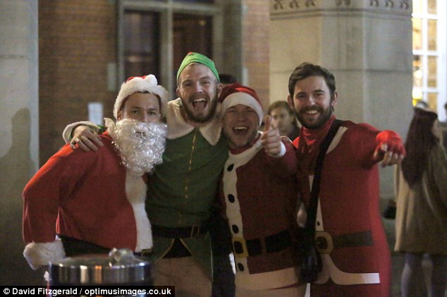 Groups of friends dressed as Santa Claus and elves as they celebrated the busiest night for Christmas office parties in London