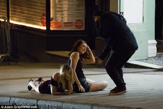 A couple of girls lie in the middle of the street after falling over in Bristol city centre last night