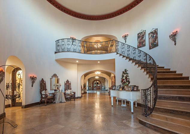 Palatial: The huge mansion boasts an impressive entrance hall, seven bedrooms and nine-and-a-half bathrooms