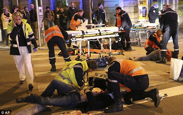 In Dijon emergency services care for people mowed down by an Islamic convert who ploughed a Renault Clio into crowds on Sunday night