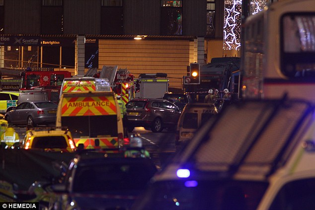 Emergency services including paramedics, police and firefighters at the scene in Glasgow's Queen Street tonight