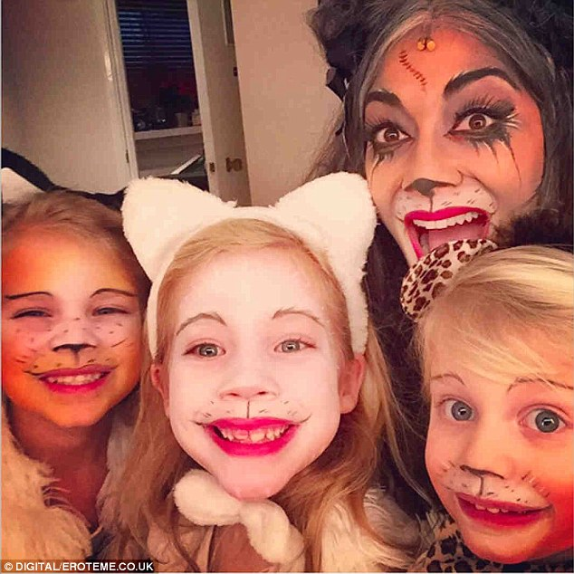 Miaow-vellous: She posted this adorable snap of herself with her nieces who had all had their faces painted