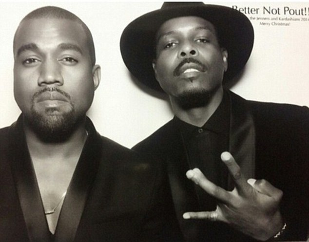 Kanye made the event too: West (left) was also at the fete; he posed with a male friend who flashed a hand sign