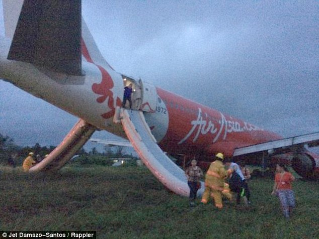 Escape:Local journalist Jet Damazo-Santos was on board the plane and uploaded photographs to Twitter showing chaotic scenes as passengers were forced to disembark the aircraft on emergency slides