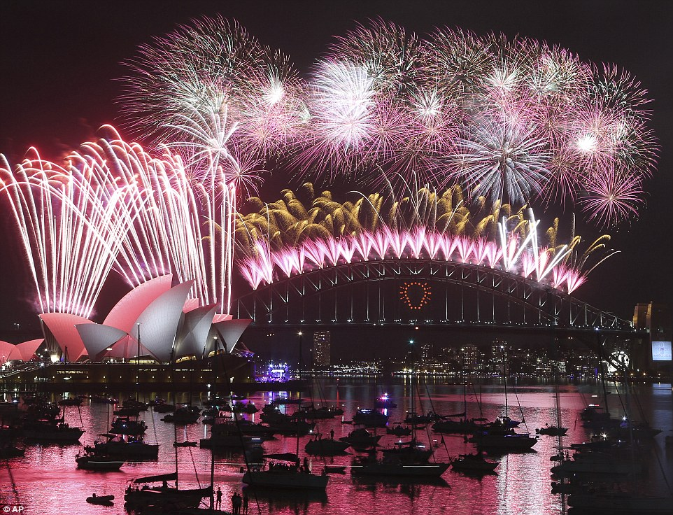 Nearly there: Thousands of people watched the fireworks in Sydney from some 50 vessels in the water