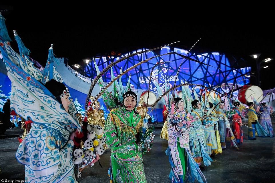 Actors carried feathers and wore a range of colourful outfits for the event in Beijing as the city counted in 2015