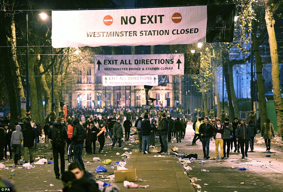 Litter on the streets: People walking along Victoria Embankment after the fireworks display over the London Eye, in central London