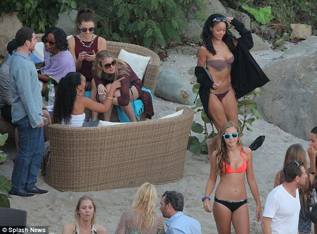 Beach party: Rihanna relaxed with friends on Shell Beach at the Do Brasil beach bar