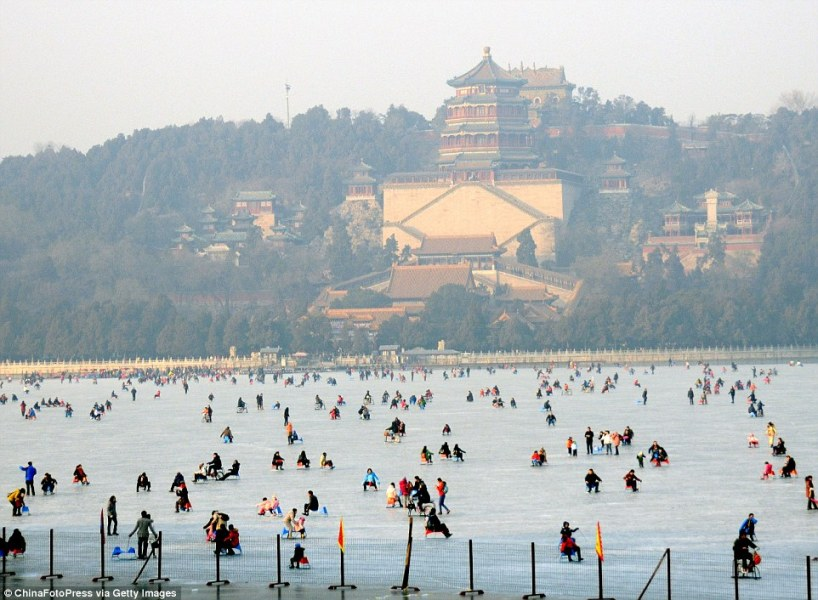 Beijing boating lake freezes solid so tourists take special carts     Dozens of tourists took sledges and carts onto Kunming Lake  part of the  Summer Palace