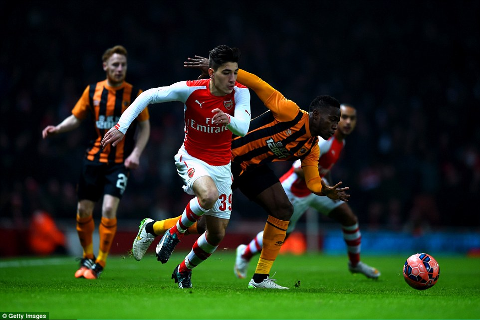 Arsenal youngster Hector Bellerin (centre) uses his pace to get past Maynor Figueroa of Hull City