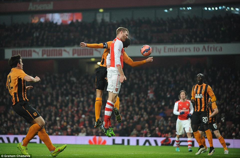 Arsenal captain Per Mertesacker rises above Curtis Davies  to open the scoring with a towering header in the first half