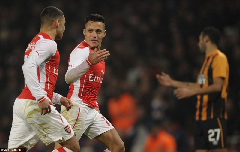 The Chilean forward is congratulated by Arsenal team-mate Oxlade-Chamberlain as the Gunners go through to the next round