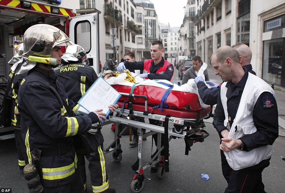 Several people were left critically wounded when terrorists carried out a 'military-style' attack on the newspaper office