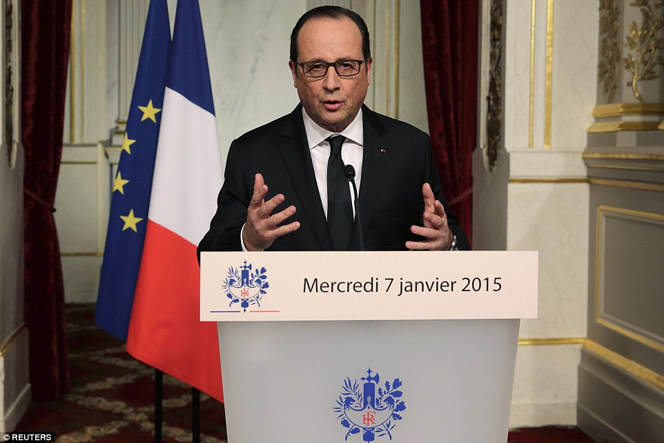 The protests were held as French President Francoise Hollande (pictured tonight) declared tomorrow a national day of mourning