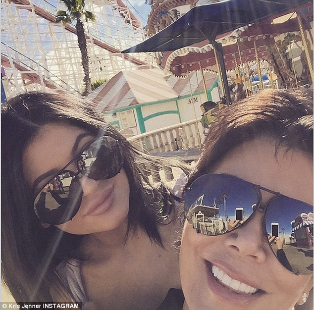 Who needs coffee? Kylie Jenner, left, and her mom Kris Jenner, right, perked up with an early morning roller coaster ride at San Diego's Belmont Park on Wednesday