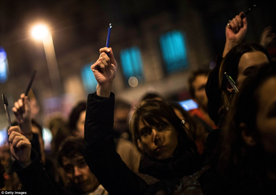 Barcelona: In a sign of support of the journalists who lost their lives today, protesters held pens, pencils and notebooks in the air