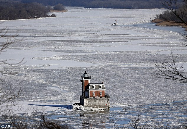 The Hudson-Athens Lighthouse is surrounded by the icy waters of the Hudson River on Thursday, January 8, 2015, in Hudson, New York