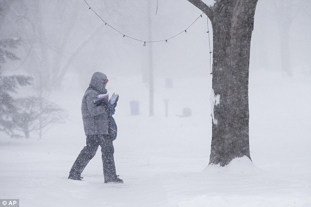 It's officially colder than Mars: NASA recorded a daytime high of 17.6 F on Mars today, which was warmer than many parts of the Midwest and Northeast. Above, a postal service worker braves the cold in Rockford, Illinois where the high was 18 F